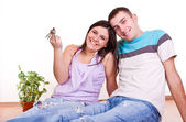 Young couple wiht keys in new apartment — Stock Photo