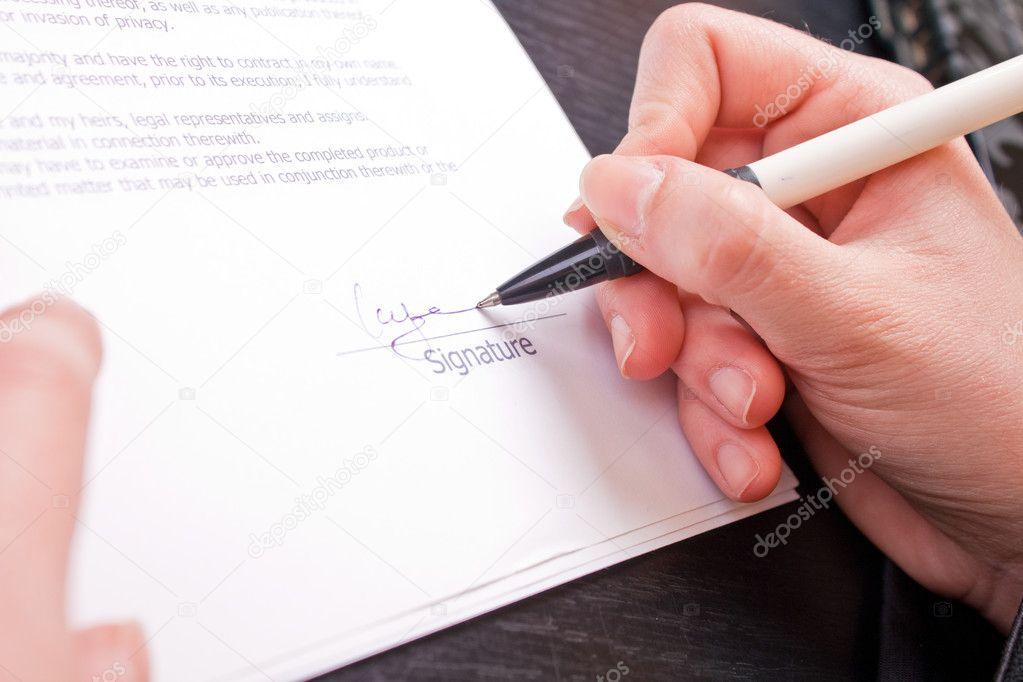 Close-up of a womans hand holding pen and signing papers — Stock Photo #2627049
