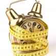 Alarm Clock with yellow measuring tape — Stock Photo