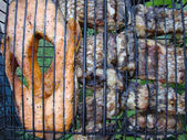 Fish steak cooking on a grill — Stock Photo