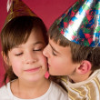 Boy and girl  in christmas caps - Stock Photo