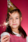 Child watching a cool firework, sparklers — Stock Photo