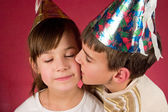 Boy and girl in christmas caps — Stock Photo