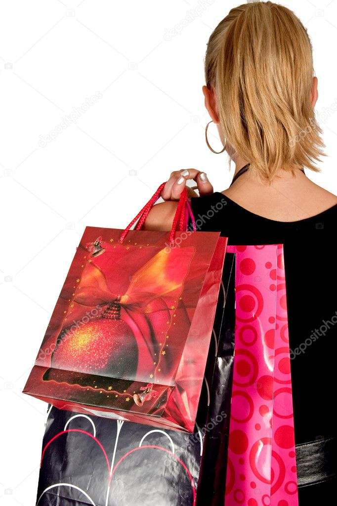 Girl in black holding shopping bags  Foto Stock #1901110