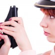Girl with a gun — Stock Photo