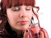 Woman with bottle of perfume — Stock Photo
