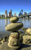 Balancing Rocks against City Skyline — Stock Photo