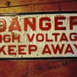 Stock Photo: Grunge Danger High Voltage Sign