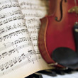 Stock Photo: Music Sheets with Blur Violin Piano