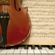 Stock Photo: Violin Piano Keys and Music Sheets
