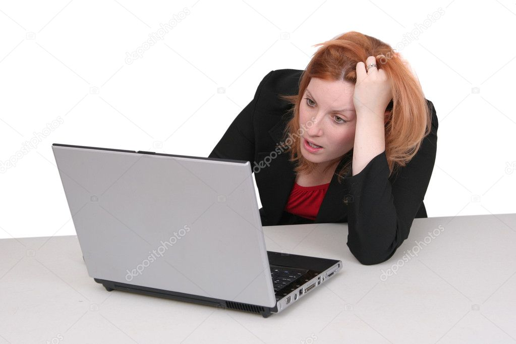 One young adult red haired business lady in black and red over white frustrated with her computer — Stock Photo #1865299