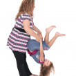 Mom flipping daughter — Stock Photo