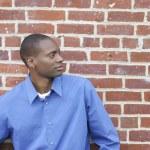 Guy against brick wall — Stock Photo #2036533