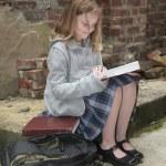 Schoolgirl reading outside — Stock Photo #2037625