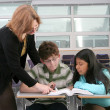 Stock Photo: 2 students and teacher