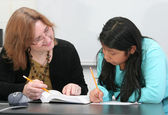 Teacher helping student — Stock Photo