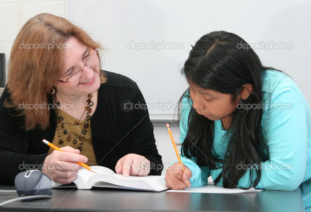 One young female student getting help from a teacher — Stock Photo #2038715