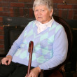Elderly lady sitting - Stock Photo