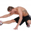 Workout guy stretching — Stock Photo
