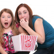 Sisters eating popcorn — Stock Photo #2043164