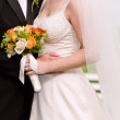 Bride, groom and bouquet — Stock Photo
