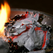 Burned paper and fire - Foto Stock