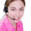 Happy woman on telephone headset - Stock Photo