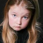 Sad looking girl face — Stock Photo