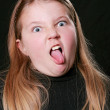 Stock Photo: Girl making a silly face