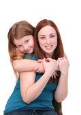 Sisters hugging — Stock Photo