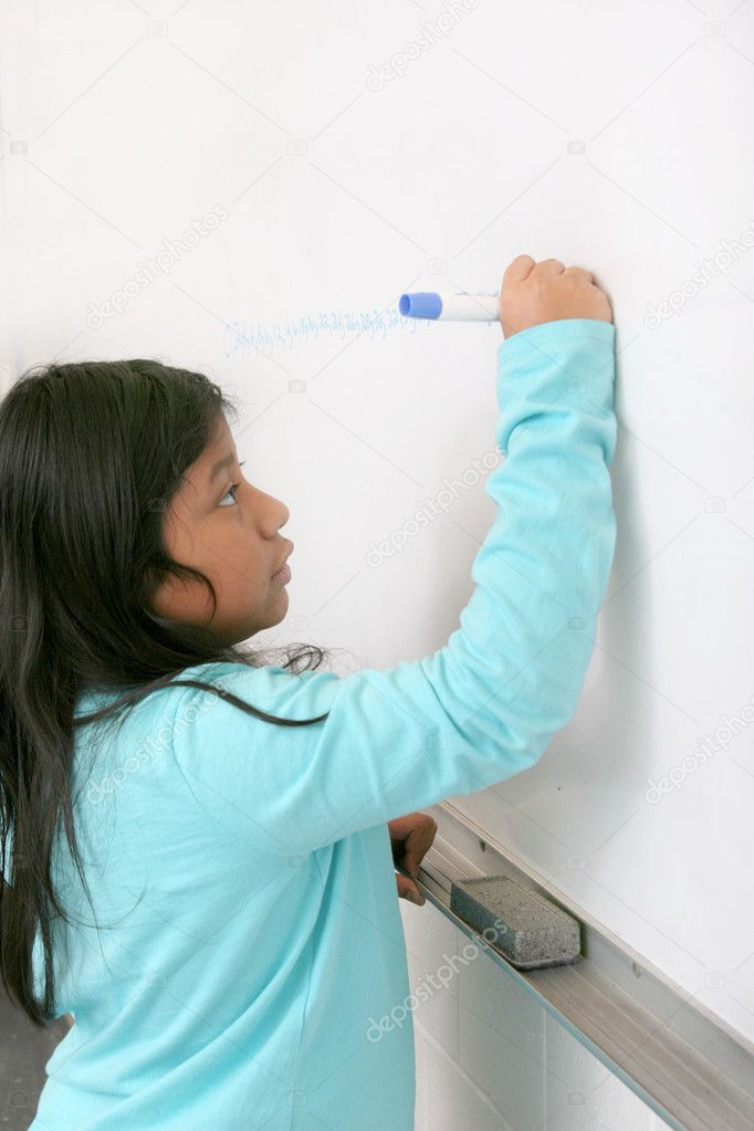 One young student writing on a blank whiteboard — Stock Photo #2040424