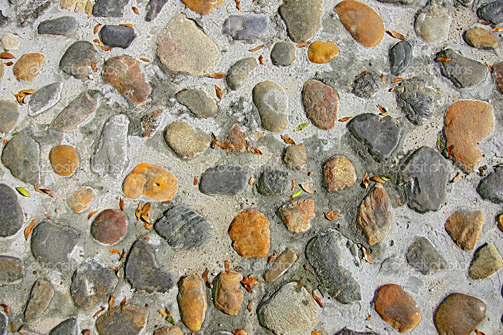 Hard stone texture of pebbles in a cobblestone road  Stock Photo #2042040