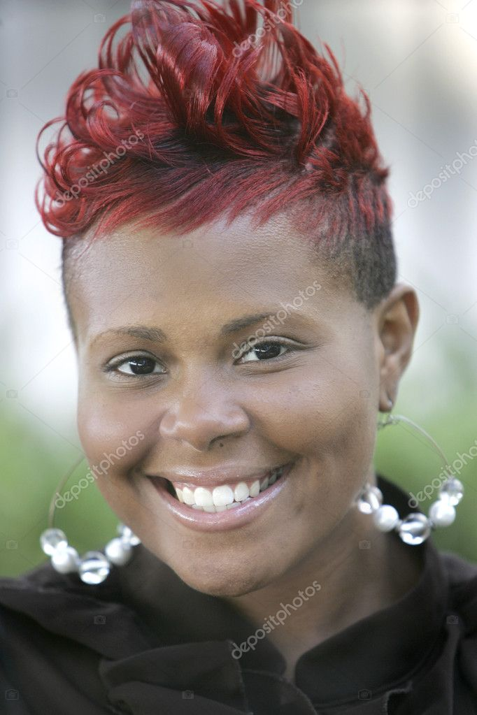 Pretty smiling African American woman closeup headshot portrait outdoors  Stock Photo #2042042