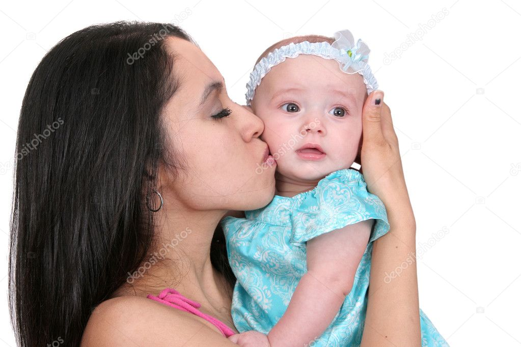 One young dark haired mother in pink kissing her young baby girl child  Stock Photo #2043389