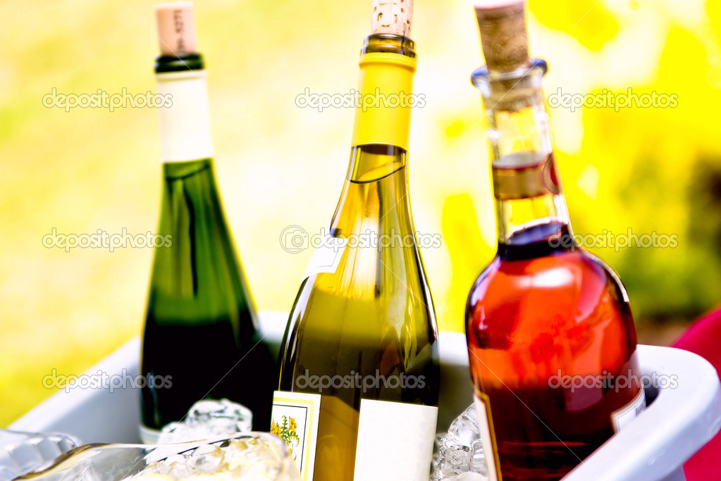 Three bottles of wine in red, yellow and green — Stock Photo #2047837