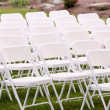 White chairs arranged — Stock Photo