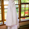 Hanging wedding dress — Stock Photo