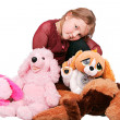 Girl and stuffed animals — Stock Photo