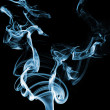 Blue smoke on black — Stock Photo
