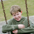Young boy on swingset — Stock Photo