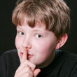 Royalty-Free Stock Photo: Boy saying shh quiet down