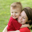 Stock Photo: Mother and son smiling portrait