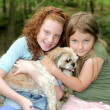 Two girls and a dog — Stock Photo