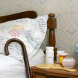 Stock Photo: Pills on bedside table