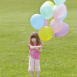 Young girl with balloons — Stock Photo