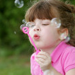 Girl blowing bubbles — Stock Photo #2175982