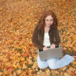 Stock Photo: Woman on laptop outdoors