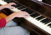 Woman's hands playing a piano — Stock Photo