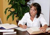 Female businesswoman taking notes — Stock Photo