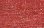 Chipped red paint texture — Stock Photo